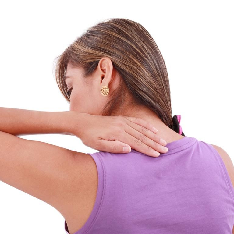 Back view of sport woman with pain in her neck. Isolated